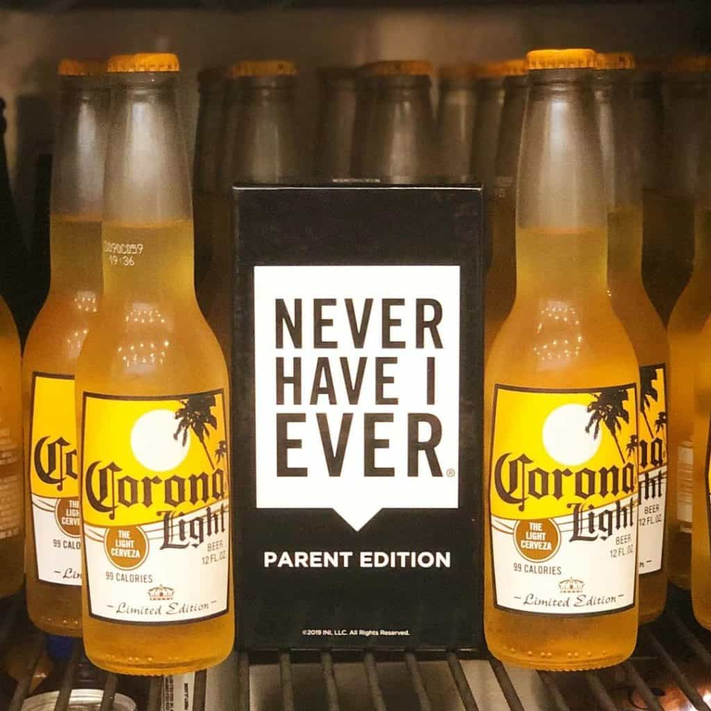 Never Have I ever Game Parent Edition Box with Bottles of Corona Light Beer